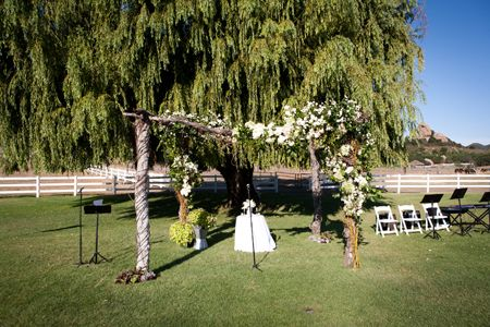Venue: Saddlerock Ranch  Event Coordinator: Party Designs by Carol  Cake: Sweet Lady Jane  Caterer: Great Taste Catering  Entertainment: Classic Photo Booth  Florist: Jonathan Ryan Floral Art  Hair: Angela Oritz  Lighting: Images by Lighting  Linens: Town and Country  Music: DeBois Entertainment  Photography: Jay Lawrence Goldman Photography  Security: Sandman Security  Transportation: Corporate Coach  Videographer: Vidicam