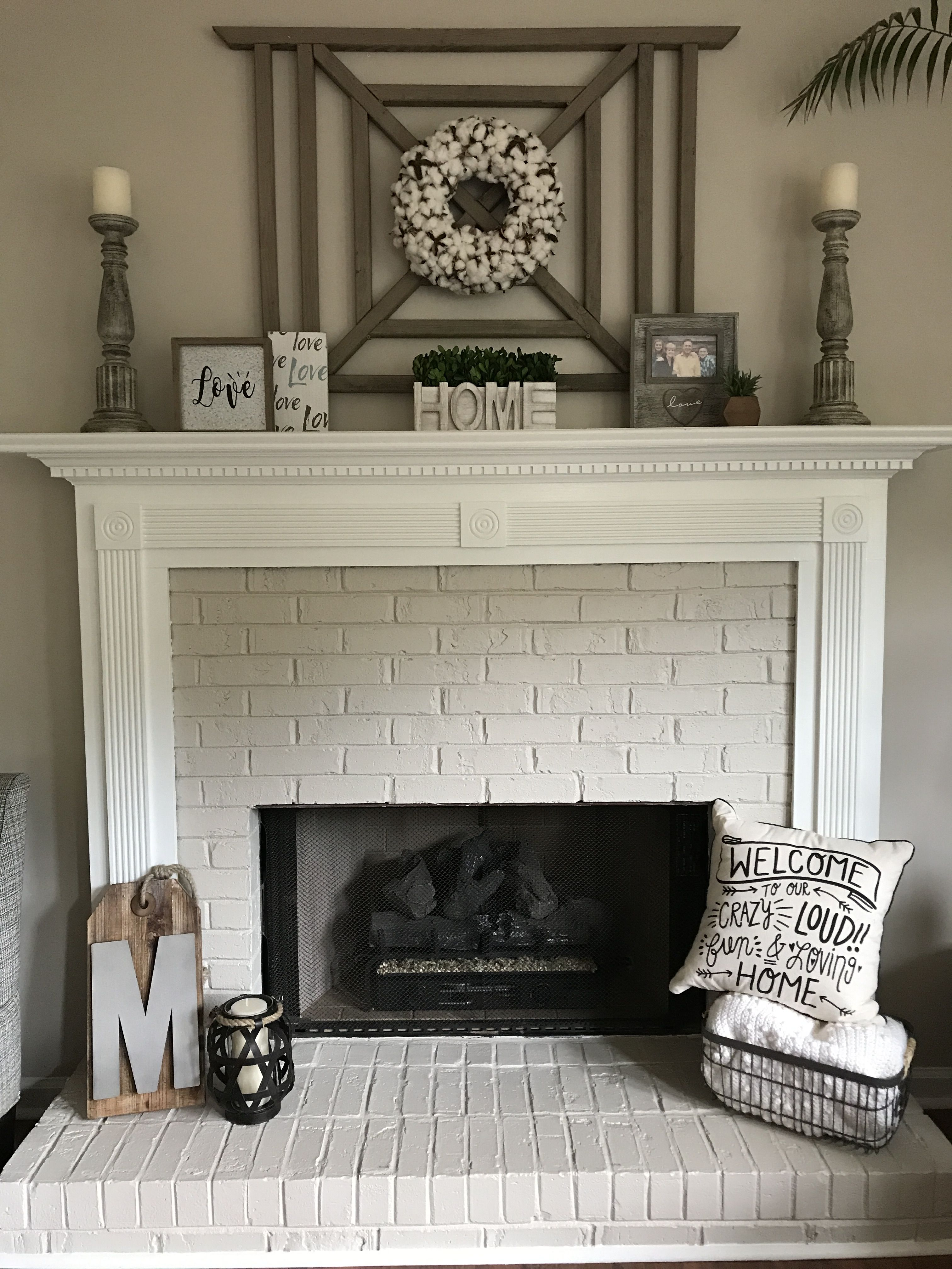Painted Brick Fireplace And Mantle With Cotton Wreath Farmhouse Fireplace Decor Farmhouse Fireplace Mantels Painted Brick Fireplaces
