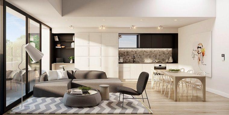 Cucina soggiorno ambiente unico, zona giorno con tappeto e un divano ...