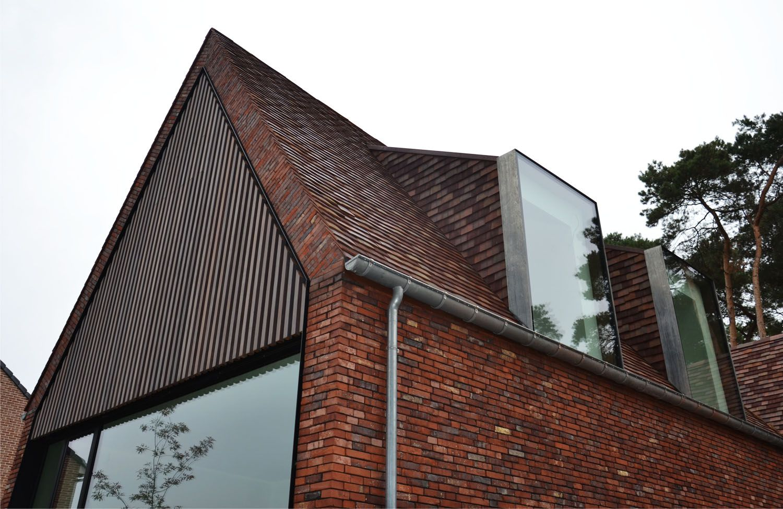 Moderne oplossing voor een dakkapel het contrast tussen oud en
