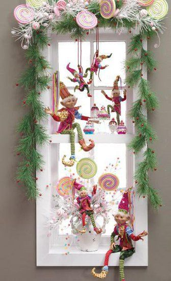 window decorated with garland lollipops and whimsical elves found in the raz candy wonderland collection