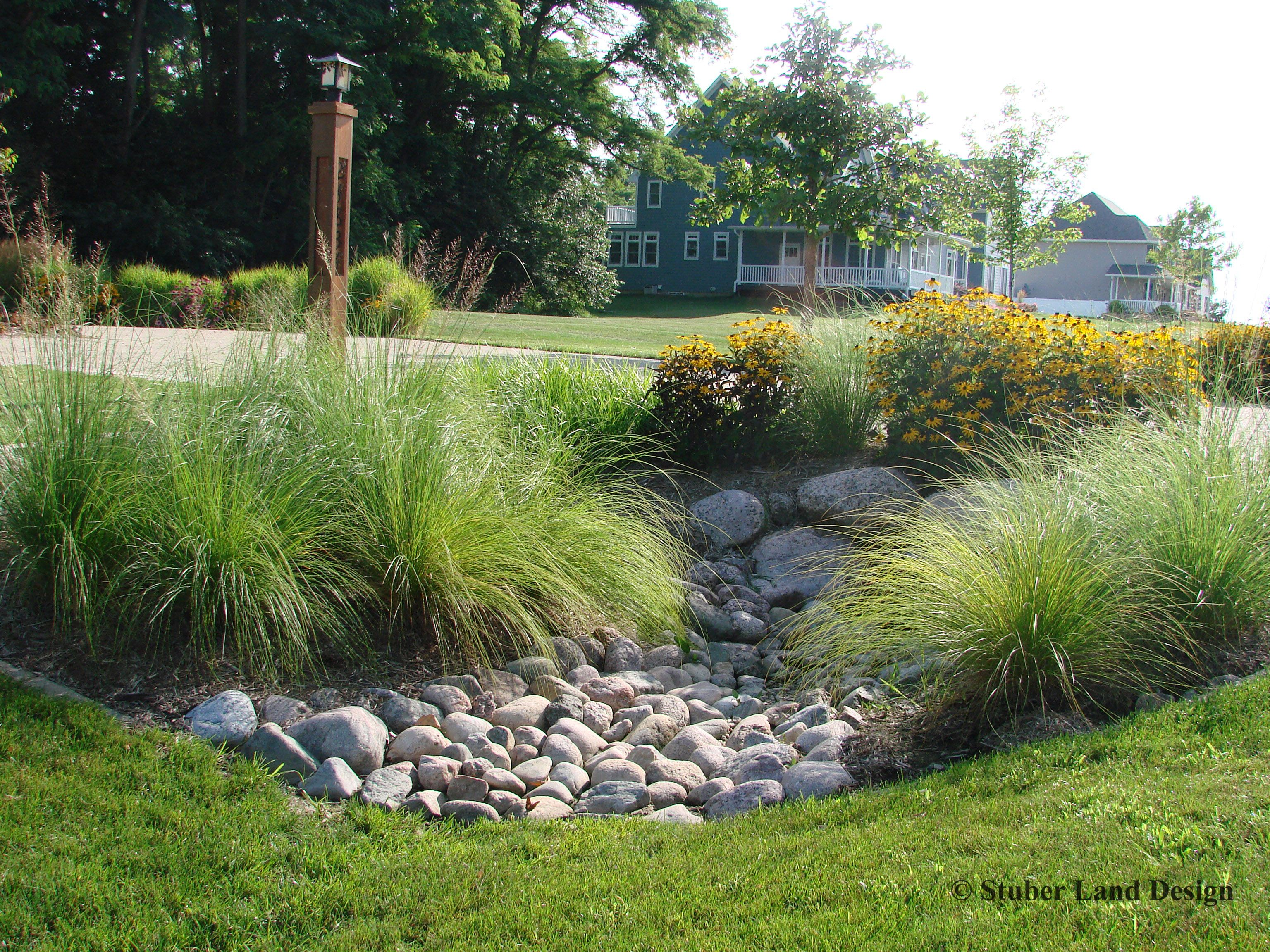small granite boulders and cobble stones mixed with perennial
