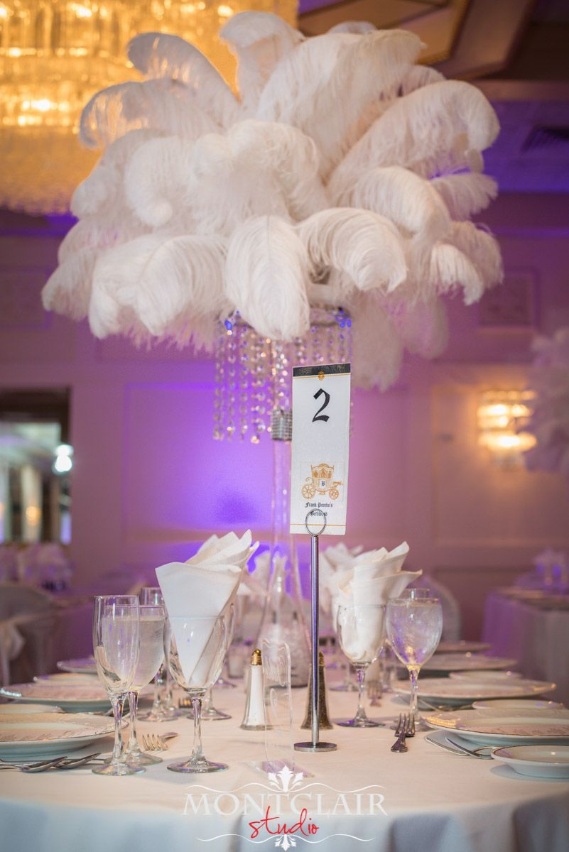 White ostrich feather with crystal chandelier centerpieces