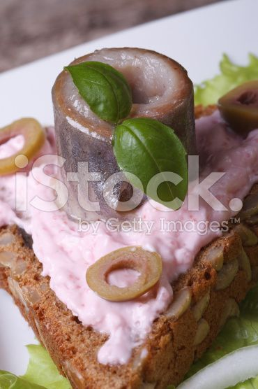 sandwich with herring, butter pink, basil and olives royalty-free stock photo