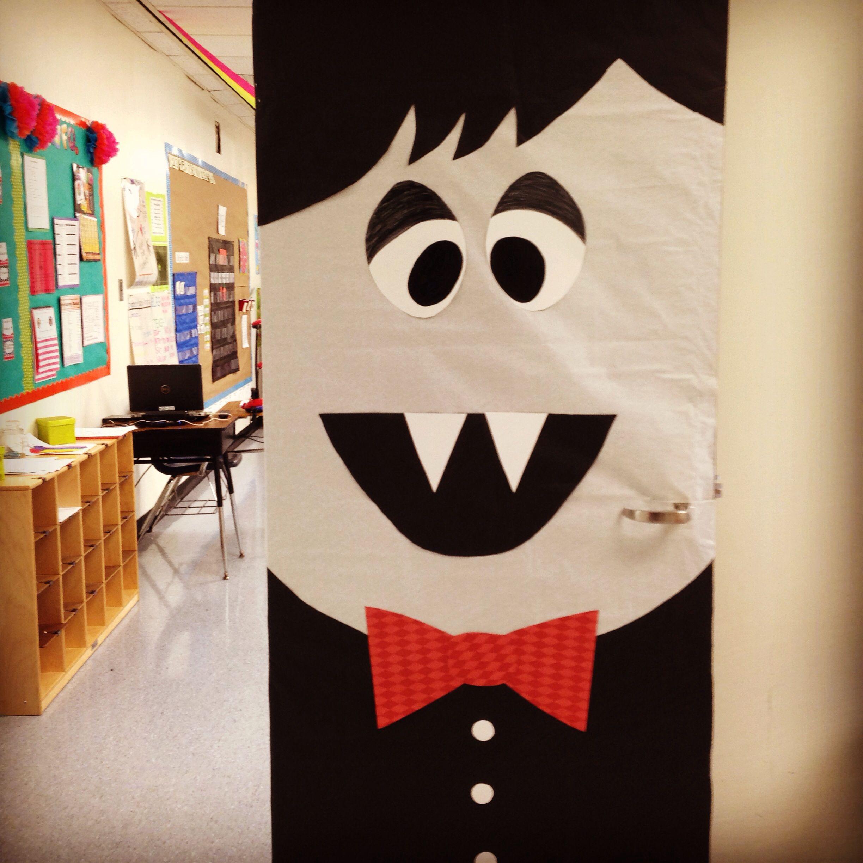 Students can cut (fine motor) out shapes (geometry) Halloween Door Decor- kindergarten #halloweendoordecorations