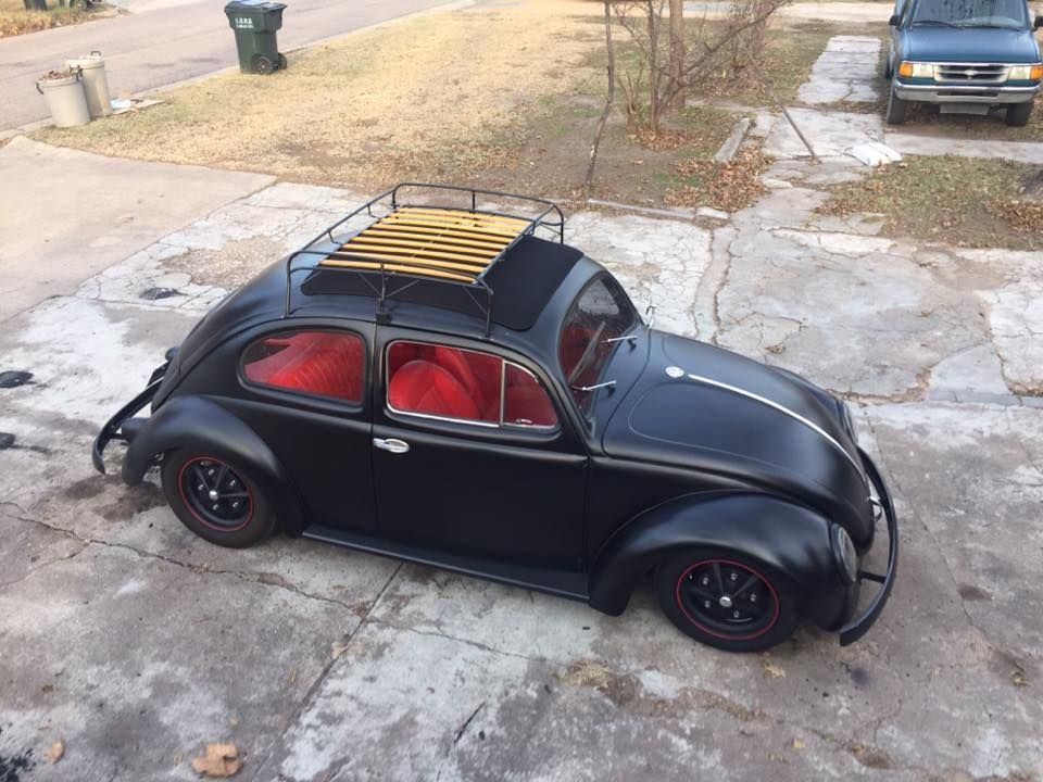 Really Slick Vw Beetle In Flat Black On Black Wheels And Rocking A Really Cool Roof Rack And A Red Interior Pic 1 Volkswagen Beetle Volkswagen Beetle