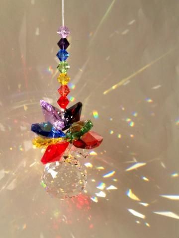 Gorgeous sun catchers made with crystals....she also does jewelry and more.