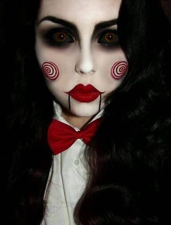 Dark clown Halloween makeup. This style of makeup plays with white, black and dark ted tones on the face. Dark rainbow sclera contacts are then added to complete the creepy look.