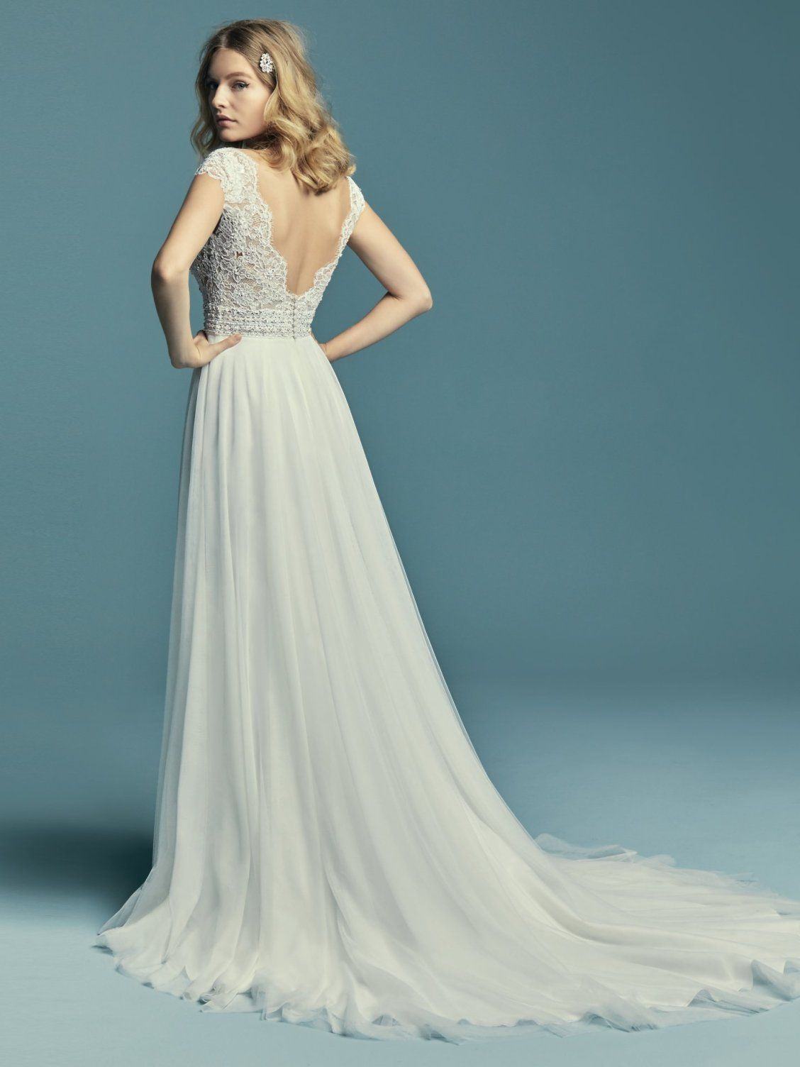 b25f7a1dc2e1 Maggie Sottero - MONARCH, Delicate lace motifs accent the bodice in this  boho wedding dress