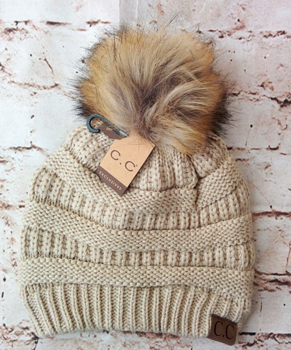 A little twist on the popular CC beanie hats - a faux fur pom pom on 5299fe5bdb5