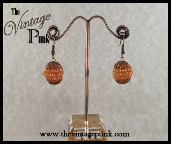 Add a pop of color with these adorable Copper Peach Berry Bead Cluster Earrings. On sale now! ~$8  http://www.thevintagepunk.com/shop/copper-peach-berry-bead-cluster-earrings/        Visit us @www.thevintagepunk.com for more great designs.  @Facebook.com/thevintagepunkjewelry/ @Instagram.com/thevintagepunkjewelry/      #vintage jewelry#handcrafted jewelry#steampunk jewelry#vintagewithatwist#The Vintage Punk