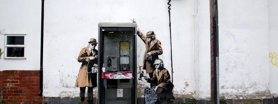 212949_possible_banksy_artwork_around_a_telephone_box-1.jpg