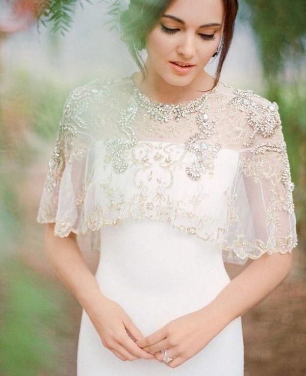 f919708475 bride with lace and beaded jacket for a spring or summer wedding   myweddingdotcom