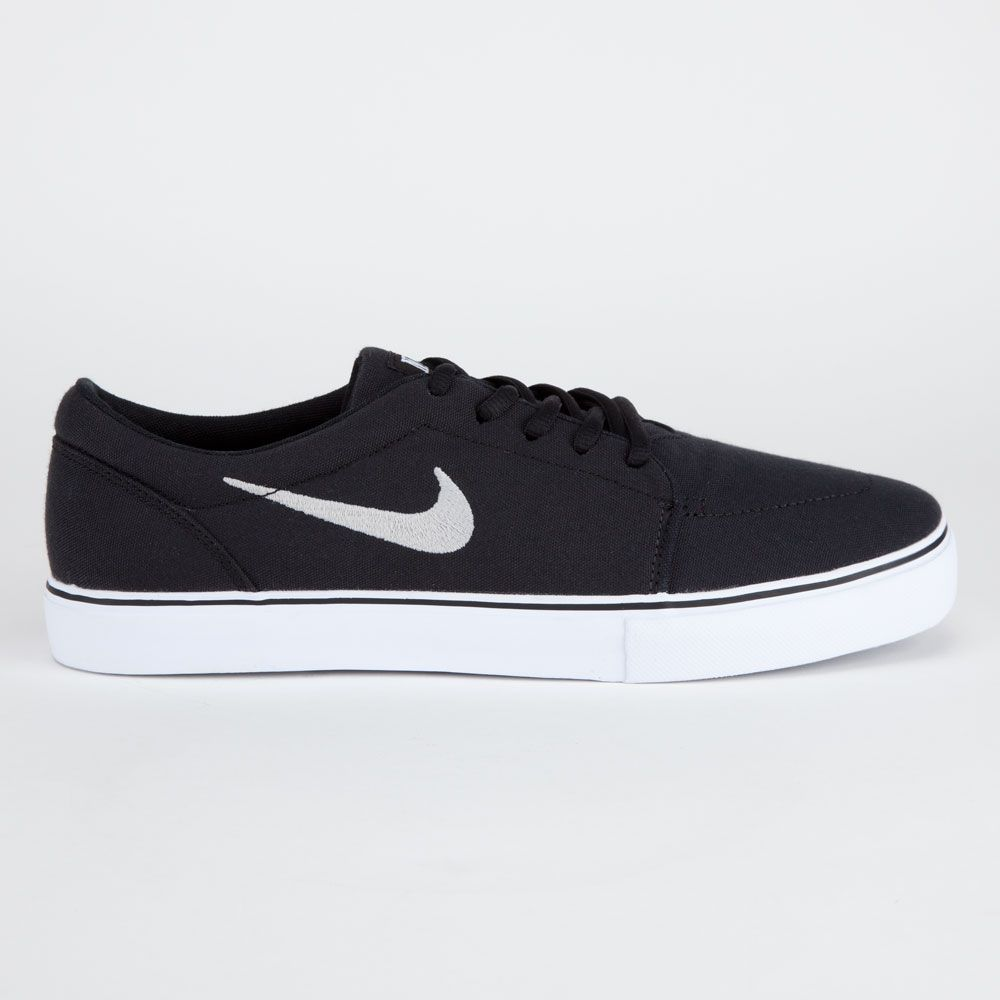 Nike SB Satire Canvas shoes. Canvas upper with Nike SB swoosh embroidery at  side.