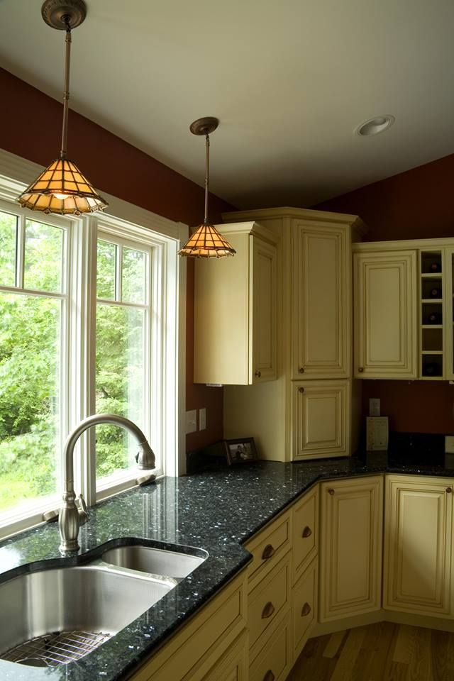 A very nice Kitchen detail showing granite counter with integrated window sill, as well as lighting and cabinet choices.