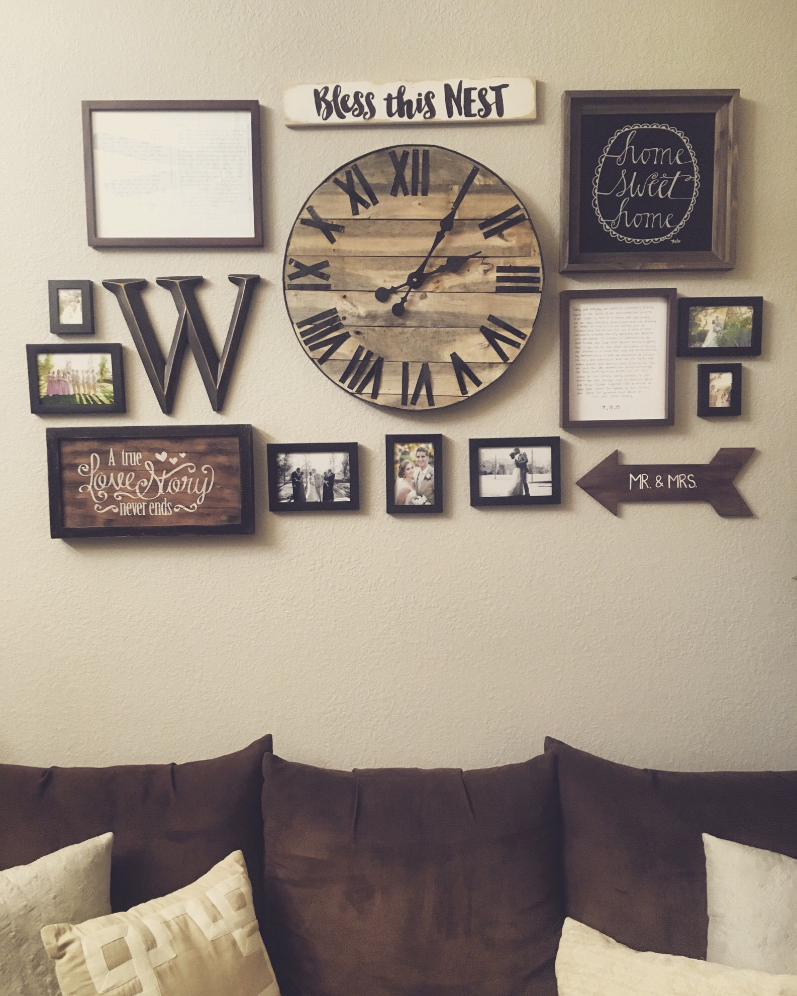 Gallery wall with handmade pallet clock http://hubz.info/98/this ...