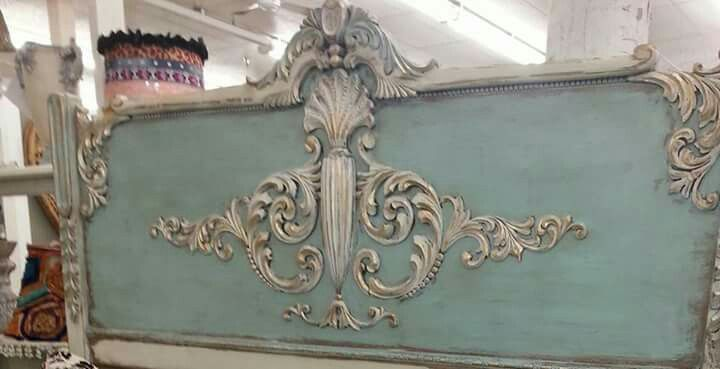 Make your own headboard similar to this one by using carved wood