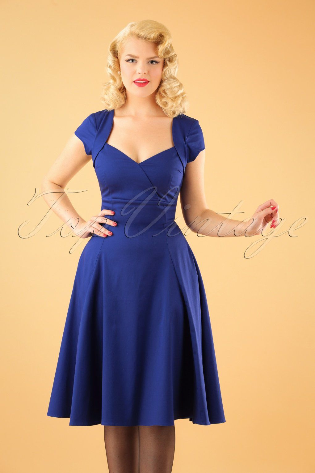 c311170ad6 Dress it up or keep it classy... you're ready for any occasion when wearing  this 50s Regina Doll Swing Dress in Royal Blue! Elegant, comfortable and  playful ...
