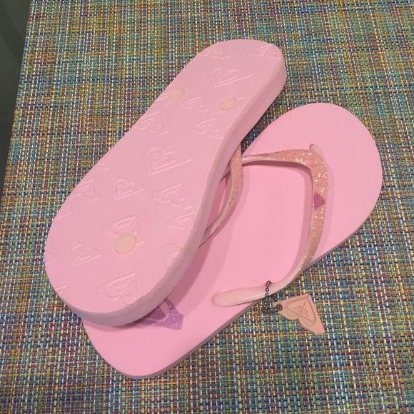 NWOT Roxy pink glitter flip flops, size 7 NWOT Roxy pink glitter flip flops. Roxy Shoes Sandals