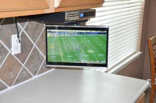 Tv Mounted Under Cabinet For Kitchen On The Wish List For The New House Mounted Tv Tv In Kitchen Large Tv