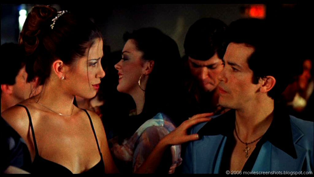 Mira Sorvino and John Leguizamo at a disco in Summer of Sam | Film ...