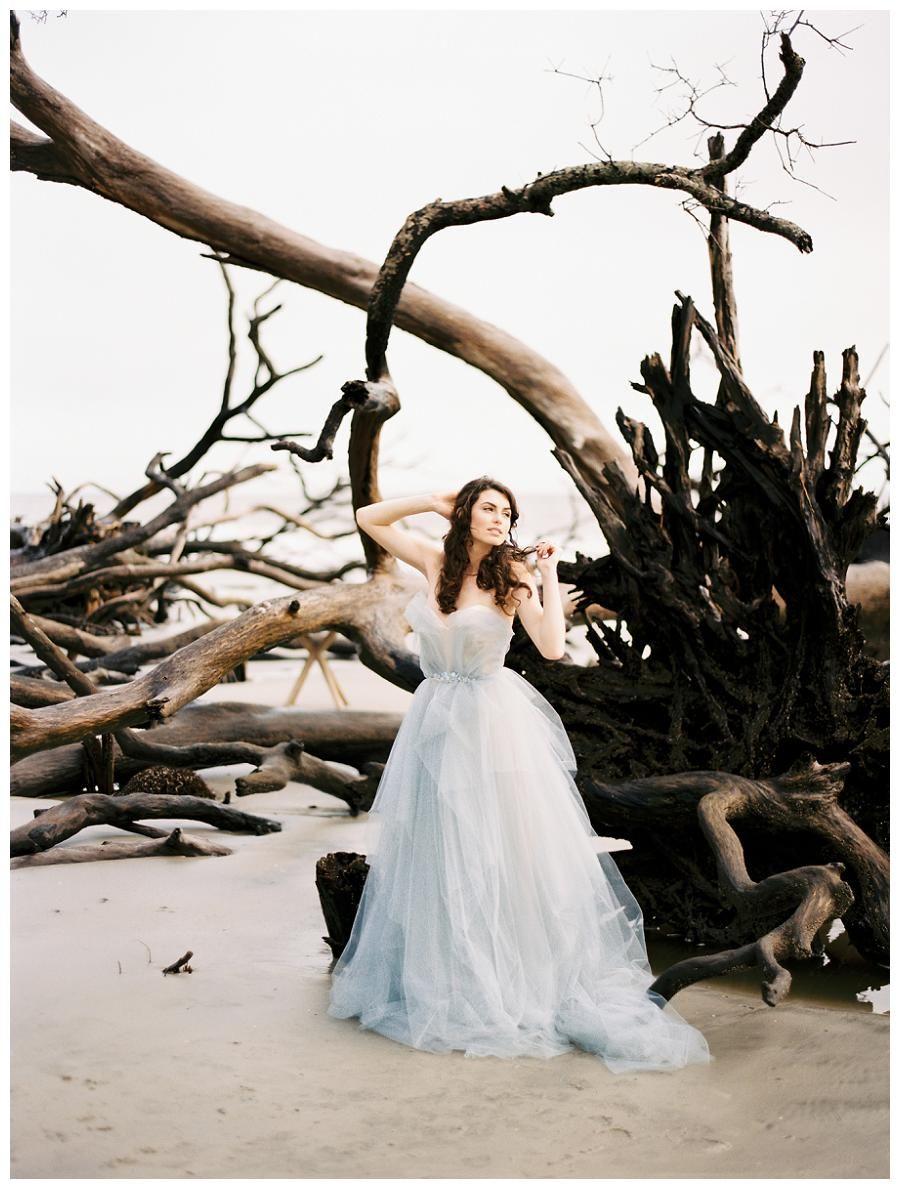 Bridal portrait by the sea blue wedding dress by carol hannah hair