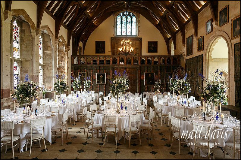 The Great Hall At Berkeley Castle Packed With Candelabras And Wedding Flowers