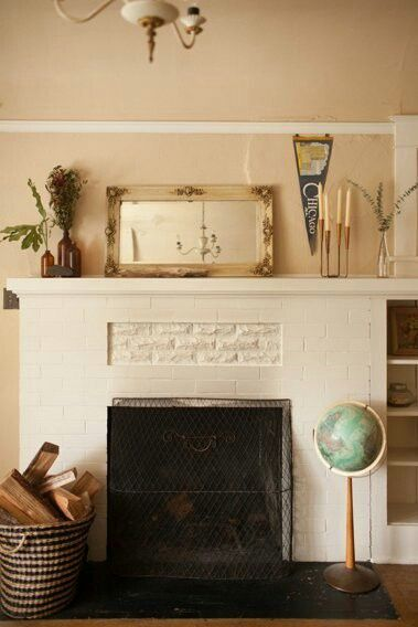 White brick fireplace, seen at Apartment Therapy