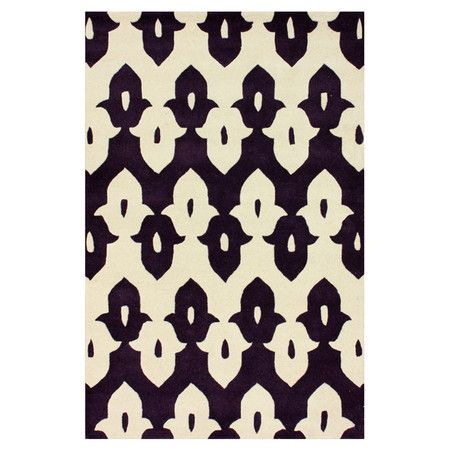 Add a pop of pattern to your entryway or den with this eye-catching wool rug, showcasing a geometric motif and purple hue.   Product...