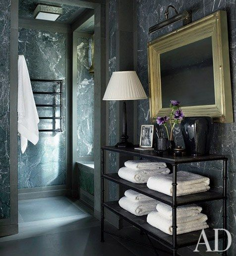 A Jean de Merry étagère in this dark and masculine bathroom | archdigest.com