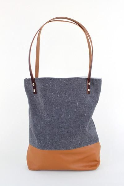 This leatherblocked tote is perfect for holding your work stuff, school stuff, and fun stuff.