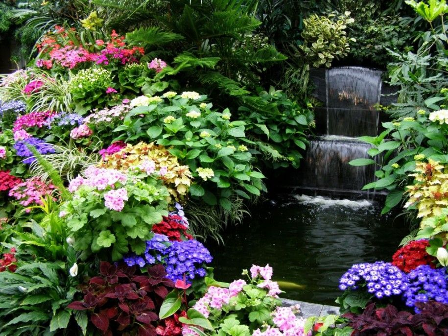 the flowers are pretty around this waterfall - Beautiful Flower Gardens Waterfalls