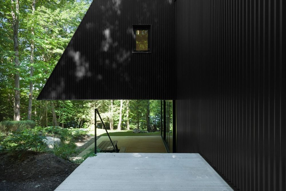 Contemporary home surrounded by natural forest. FAHOUSE designed by Jean Verville.