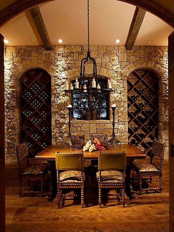 Mediterranean wine cellar with maxim notre dame chandelier 295w great mediterranean wine cellar with high ceiling built in bookshelf aloadofball Choice Image