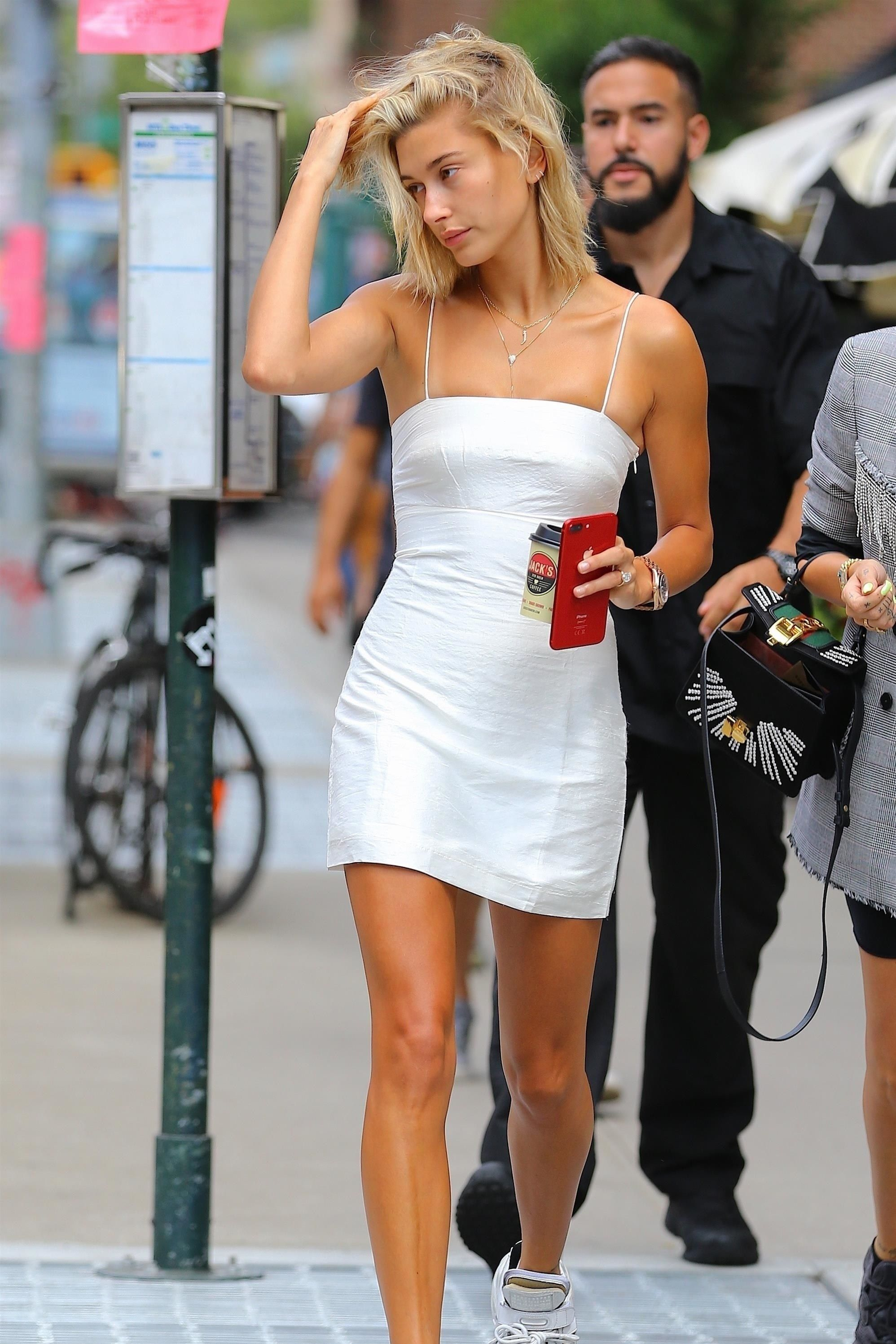 8a6043138c44e Hailey Baldwin heads out in New York in a sexy bright mini dress Revenge  Body,