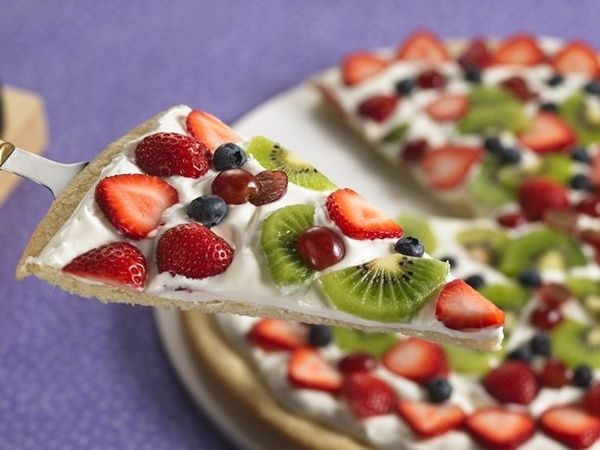 Spring Fruit Pizza    1 pouch (1 lb 1.5 oz) Betty Crocker sugar cookie mix     1/2 cup butter or margarine, melted     1 egg     1 cup whipping cream     1/2 cup Betty Crocker Rich  Creamy cream cheese frosting (from 1-lb container)     3 1/2 cups assorted fresh fruit         1 Heat oven to 375F. Lightly spray 14-inch pizza pan or 15x10- recipes