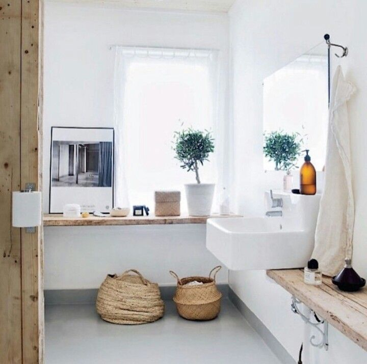 Bathroom Love. warm wood, clean white, a touch of green life