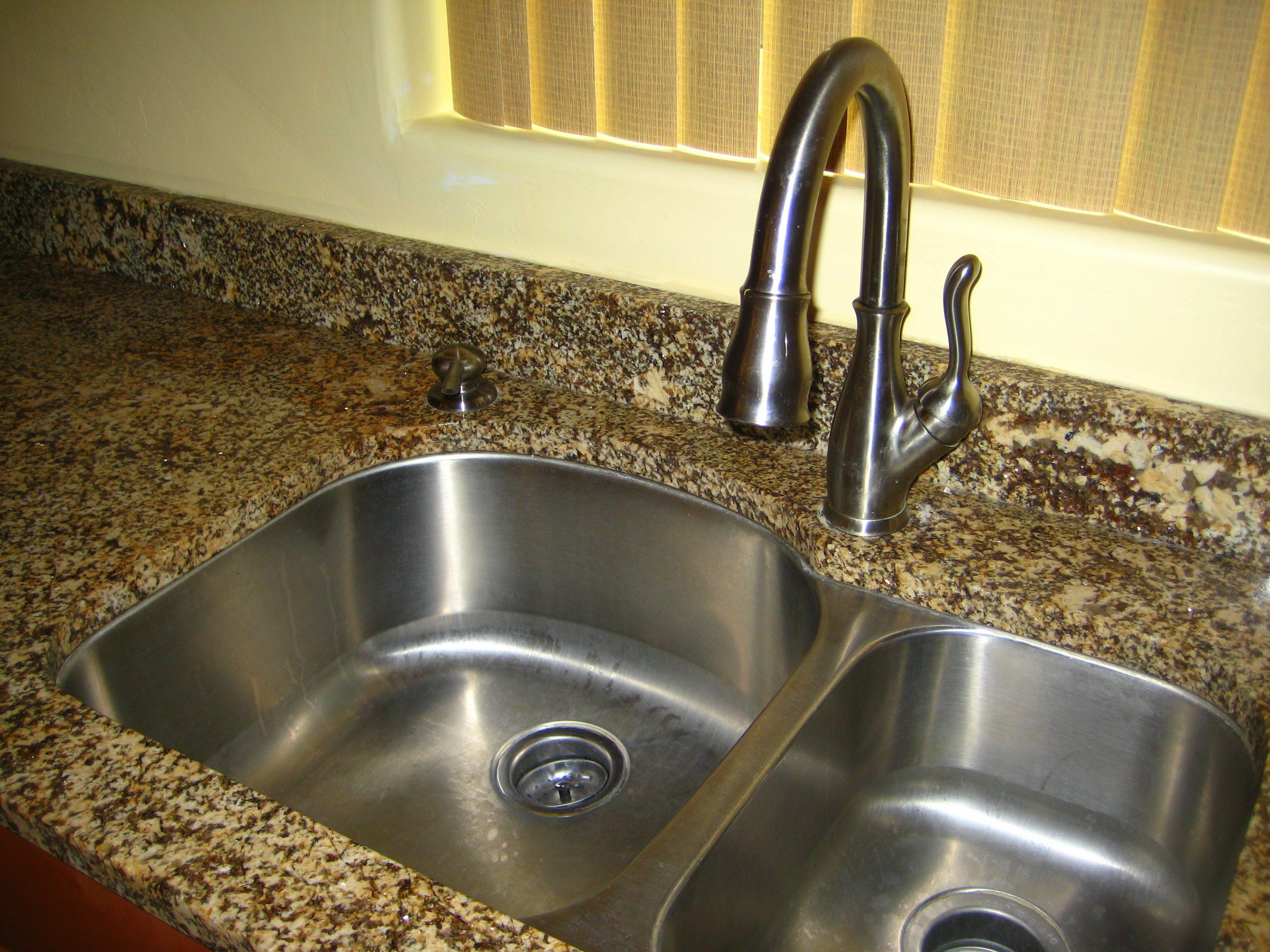 Upgraded fixtures throughout - extra deep kitchen sink and nice ...