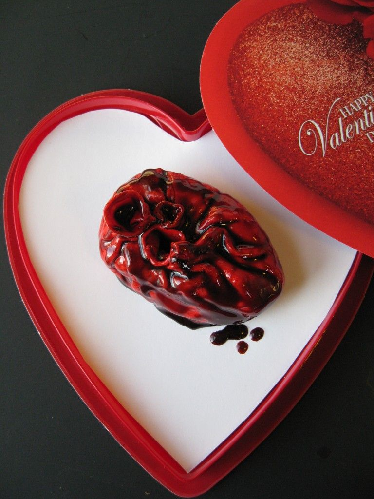 A red velvet cupcake filled with cherry filling, with cream cheese icing, wrapped in fondant made to look like a real bleeding heart. This would be the absolute best Valentine's Day gift to give to me!