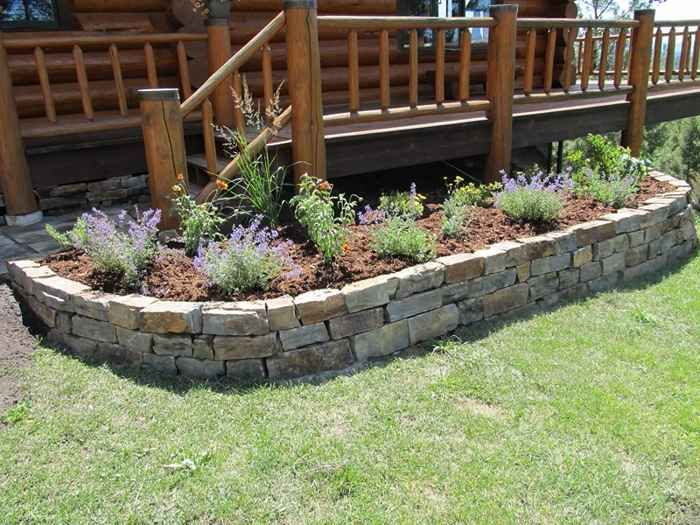 Raised flower beds stone garden pinterest raised for Landscaping flower beds with stones