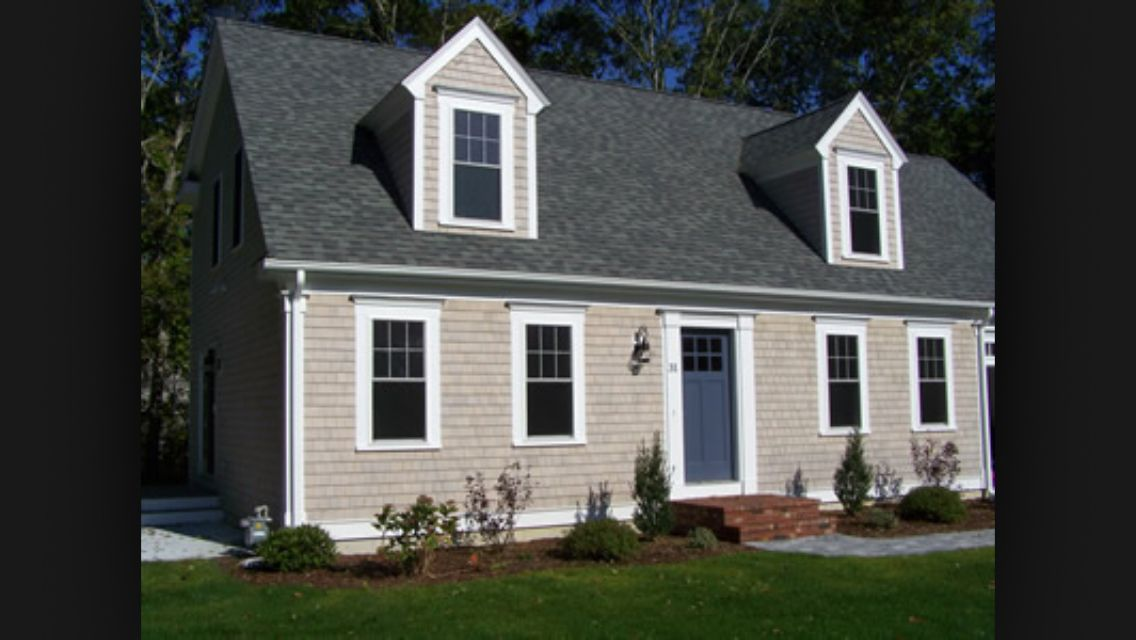 Tan With White Trim And Wood Stained Doors Cape Cod Exterior Cape Cod House Exterior Window Trim Exterior