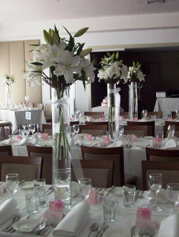 Tall Wedding Centerpieces Using Glass Cylinder Vases Lilies And Orchids