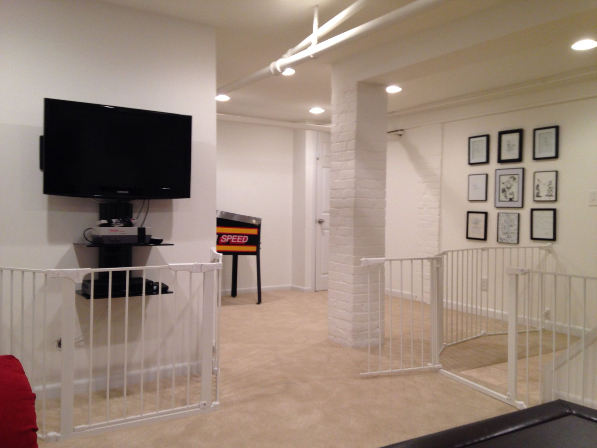 A Finished Basement With The Entertainment Center Gated Off An Additional Gate To Limit Access To The Staircase The Laundry R Baby Gates Home Baby Proofing