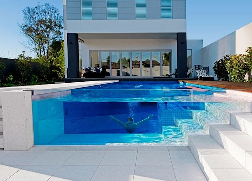 This Australian pool features a glass siding similar to that of an ...