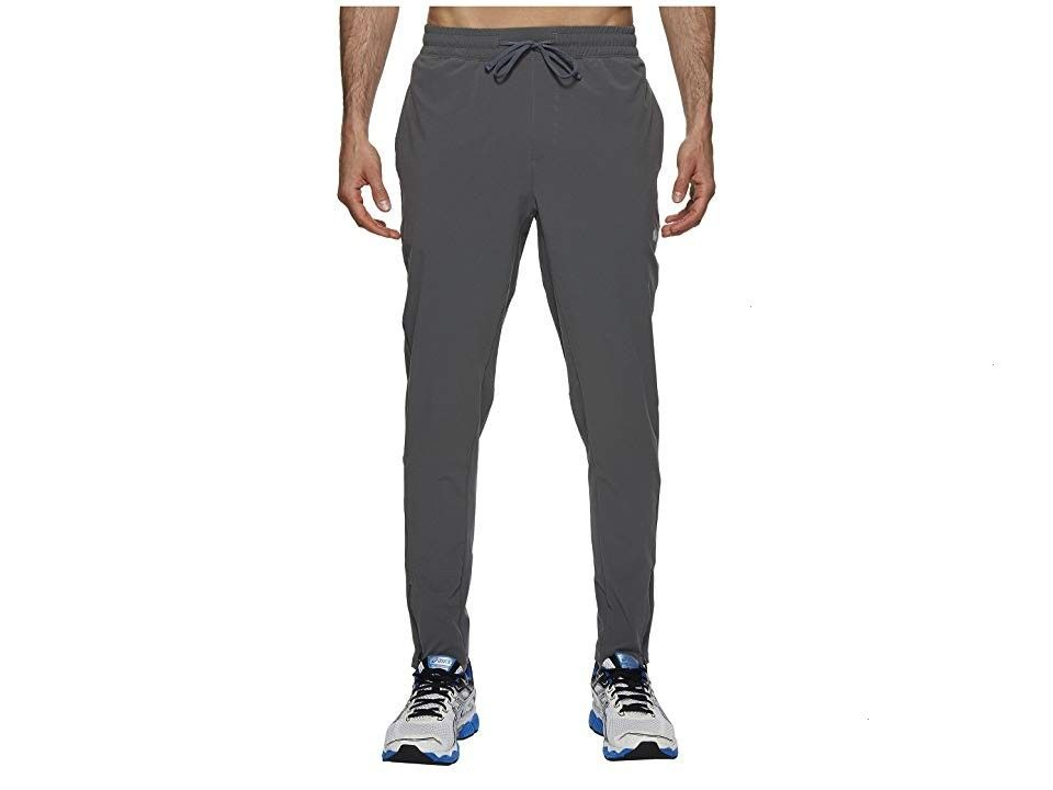 Run Woven Track Pants Castlerock Mens Workout Warming up or cooling down the ASICS Run Track Pants are built to keep up Tight fit hugs the body for maximum support during...