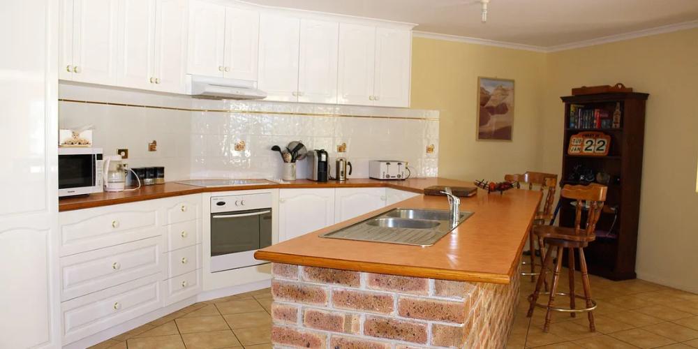 v shaped kitchen with brick island feb 20 in 2020 brick kitchen kitchen kitchen cabinets on kitchen island ideas v shape id=14259