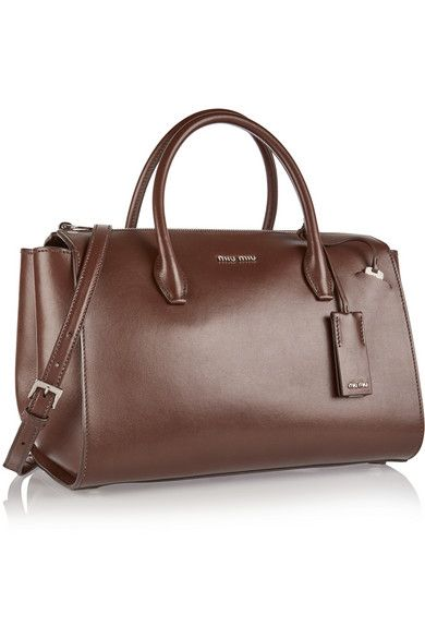 Brown leather (Calf)  Zip fastening along top Designer color: Bruciato Comes with dust bag Weighs approximately 2.4lbs/ 1.1kg
