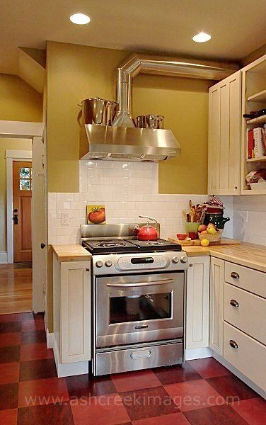 A Striking Red Linoleum Floor And Maple Butcher Block Countertops Are Highlights Of This P Kitchen Appliances Layout Outdoor Kitchen Countertops Kitchen Layout