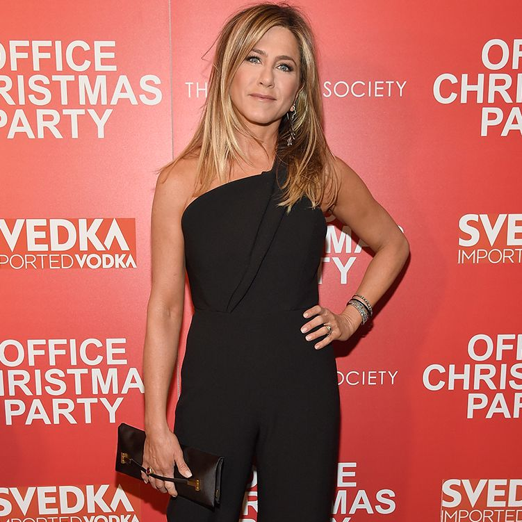 """Jennifer Aniston wore a TOM FORD Black Silk Satin East West Clutch to the """"Office Christmas Party"""" screening in New York City."""