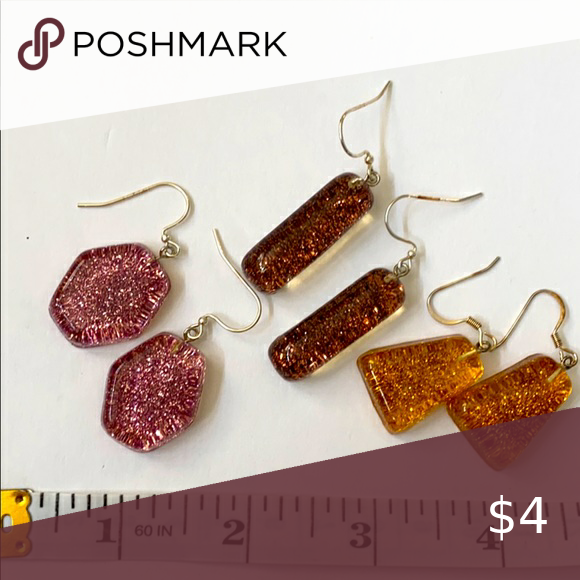 (10 for $10) 3 pairs of earrings! Pink and amber French hook Drop style Pink glitter and amber glitter Lucite Too fun! This listing is part of the (10 for $10) sale. Add ten items marked (10 for $10) to get the sale price. Jewelry Earrings